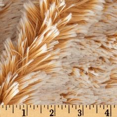 Minky Frosted Shag Cuddle Camel/Beige from @fabricdotcom    This ultra plush Minky Shaggy Cuddle fabric has a smooth surface with a shaggy texture and frosted top fibers. It's perfect for blankets, throws, pillows, mats, cozy robes, stuffed animals and more! Fabric has a 25 mm (1 inch) pile.