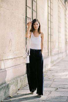 Hanneli Mustaparta in a simple white tank and velvet wide-legged trousers | via Vanessa Jackman