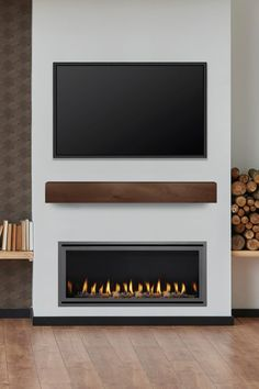 Stacked firewood paired with the Heat & Glo Cosmo linear fireplace creates natural harmony in a minimalist living room. Indoor Gas Fireplace, Linear Fireplace, Fireplace Inserts, Modern Fireplace, Brick Fireplace, Contemporary Fireplaces, Minimalist Fireplace, Minimalist Decor, Modern Minimalist