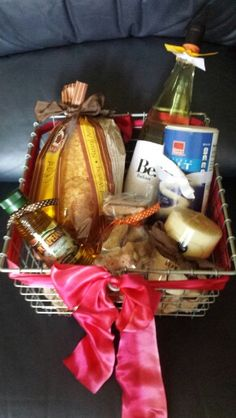 This gift basket, full of bread, oil for dipping, and wine would make a great host or hostess gift.  It would also work as an appetizer if you have to take a dish to a party!