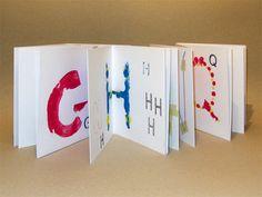 8 - Alfabetiere con lettere sia stampate che disegnate. Alcuni collage e composizioni di fili e adesivi, carte varie colorate.