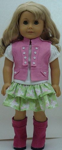 Doll outfit. Pink vest and boots, green skirt and white shirt.
