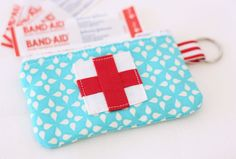 "How-to make this cute little emergency zippered pouch to hold lots of ""emergency"" supplies needed when you travel...money, credit card, chocolate, make-up, and first aid supplies."