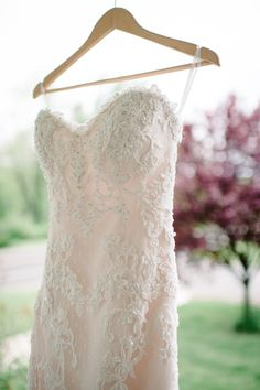 Lace wedding dress with pale pink under layer. i didnt think id like a dress with color but i love this !