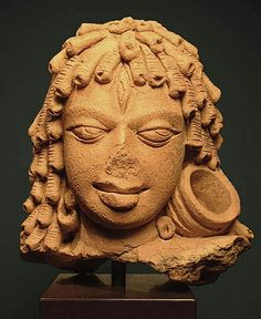 """Head with Ringlets and Earring  Eastern India,   Gupta period, circa 5th century CE  Terracotta,   height: 15.25 cm, 6""""  Arnold Lieberman"""