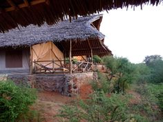 Man Eaters Camp, a luxury tented camp nestled on the banks of the Tsavo River in Tsavo National Park. Just off the main Nairobi-Mombasa highway, Man Eaters Camp is an ideal stop over for travellers along the route, with accessibility to both Tsavo East and Tsavo West. 30 luxury en suite tents each with a breath taking view of the Tsavo River, built along the river bank. The tents are spacious, cool and blend in magically with the environment.