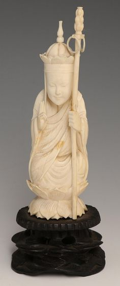 """EARLY 20TH CHINESE CARVED IVORY SEATED MONK Chinese carved ivory figure, early 20th C., monk figure with reticulated ringed staff seated atop a lotus. Unmarked, attached to base. Provenance: Private Minnesota estate. Weight: 117g with base Size: 6.25"""""""