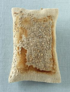 """Sachet, approx. 6""""x3"""". Rust-printed linen, hand-dyed wool, organic lavender. 2012  photo credit: Tyllie Barbosa"""