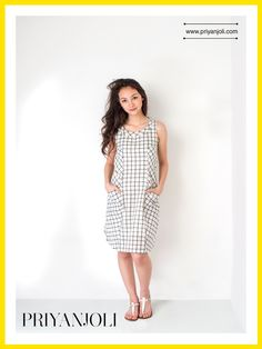 The Checked Shift Dress is crafted from exquisite organic cotton from the looms of Bengal. This fabric is a unique blend of Khadi and Mulmul and provides a special textured surface.   Perfect for a weekend of fun, the two robust diagonal pockets allow you to slip in your phone and cash and hit the town.  This simple silhouette is a globetrotter's golden ticket; just pull it on and head out looking beautiful.