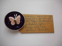 Pillsbury's Pieces No, 170. Pin - dark purple capsule with very pale pink paper butterfly. In exchange for a donation to KATHMANDU ANIMAL TREATMENT CENTRE, Nepal. Available at St. George's Church, Madrid on Saturday 13 June from 11.00 - 15.00.