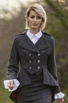 Lady Mary jacket Cuillin Tweed A fitted bodice is seamlessly tailored to combine with a luxurious peplum giving a regimental yet feminine silhouette to this updated, timeless classic jacket. The waist gently pinched and emphasised. The back styled to appear to lengthen the female form. The bust is advantaged by a Victorian era doublet-style structure. Exclusive Great Scot red embossed lining Distinguished equestrian buttons in Gunmetal finish