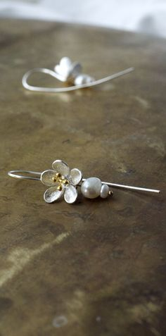 Spring floral blossom earrings in sterling silver and gold vermeil with a pearl dew drop.