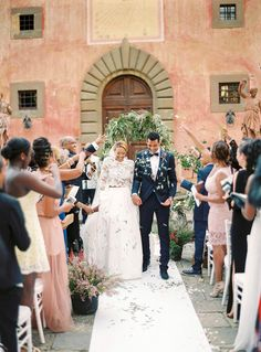 A modern take on the classic Tuscany destination wedding featuring the bride  in a two-piece Reem Acra wedding dress with long lace sleeves and a full  skirt. c49144290d95