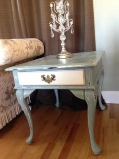 Refurbished vintage end table with Annie Sloan duck egg blue and old white chalk paint. Finished with clear Annie Sloan wax then distressed and dark waxed for an antiqued look