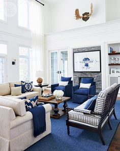 A rustic and refined family cottage on Lake Simcoe—Designer Jessica Waks gives this family's second cottage its own unique flair, creating a spot to accommodate not only guests but also generations to come. Blue And White Living Room, Navy Living Rooms, Blue Rooms, White Rooms, Home Living Room, Living Room Designs, Living Room Decor, Cottage Living, Home Interior