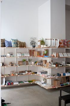 FruitSuper's New Design Store-Slash-Wine Bar Celebrates Dozens of Artisans Roman Clock, Store Design, Design Shop, Metal Clock, Store Interiors, Retail Space, Metal Wall Decor, Metal Walls, Interior Decorating