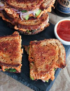 Barbecue Chicken Grilled Cheese. BBQ chicken, avocado, sautéed red onion and lots of melted mozzarella and cheddar. The ultimate loaded grilled cheese! #ComfortFoodFeast #bbq #grilledcheese