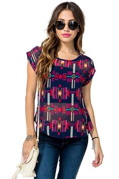 March to your own beat in this jazzy tee! Vibrant tribal-inspired print throughout. Round neck. Short sleeves. Finished hem. Semi-sheer.