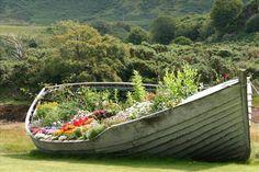 Great idea-repurposed boat for the garden!