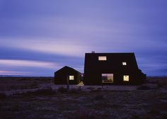 Black-stained house built on the shingle lanscape of Dungeness beach in Kent, England