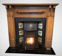 Antique tiled Art Nouveau fireplace insert with a log burner. Log Burner Fireplace, Fireplace Tv Stand, Fireplace Inserts, Fireplace Ideas, Shelves Around Fireplace, Art Nouveau Tiles, Antique Tiles, Stone Veneer, Mounted Tv