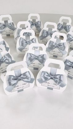 Wedding favor box with silver satin ribbon bow and custom tag. Chic bonbonniere. Elegant personalized gift boxes make a unique way to thank guests for attending your special day. #welcomebox #giftbox #personalizedgifts #weddingfavor #weddingbox #bonbonniere #sweetlove #favorboxes #candybox #partyfavor #giftboxes #uniqueweddingfavors #weddingfavours #silverwedding