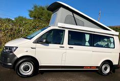 Fresh VW campervan conversion off production! Pop top roof with an awning. Vw Campervans For Sale, Van Conversion Campervan, Rock And Roll Bed, Used Hyundai, Portable Solar Panels, Dinosaur Design, Bike Rack, Car Wrap, Leather Design