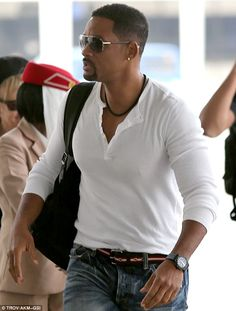 Big Willie's style: The actor was looking cool in this white pullover and trendy blue jeans