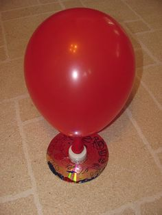 Make your own hovercraft with an old CD, a push up and down lid from a water bottle or detergent bottle and a balloon.
