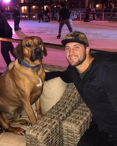 Tim Tebow and his son/dog Bronco National Dog Day