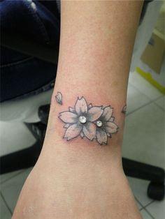 Flower+Tattoo+Dermal+Piercing