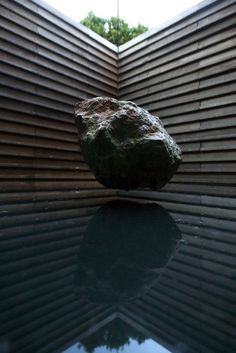 Suspended boulder - Crux Pavilion / Pezo von Ellrichshausen Architects.