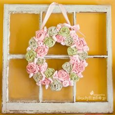 Cute diy wreath made out of two old shirts and a cereal box!
