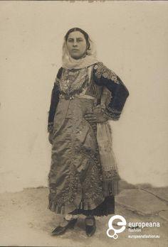 "Photo B/W photo of a woman with local costume from Megara. Inscription: ""Σύζυγος Γεωργίου Παπασωτηρίου"".  1900-1910"
