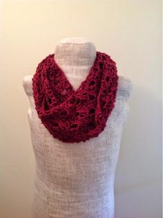 The deep red color of this Lacy Wine Infinity Scarf just has that indescribable feeling you get when you know Christmas is in the air. The crochet lace pattern also works perfectly with this scarf, making it delicate but also warm.