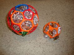 Gripper O-Ball filled with shiny mylar- old mylar balloons or emergency blankets are great.