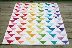 Cutting Edge Rainbow Quilt by Fresh Lemons. The Cutting Edge quilt is made up of six columns of staggered flying geese Quilting Tutorials, Quilting Projects, Quilting Designs, Quilting Patterns, Flying Geese Quilt, Rainbow Quilt, Rainbow Blocks, Half Square Triangle Quilts, Modern Quilt Patterns