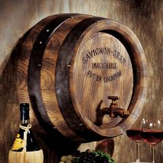 If you've ever visited a French vineyard, you'll know that white oak barrels that have outlived their usefulness line the cellar walls and this wall sculpture  brings this time-honored practice right to your kitchen or bar area.
