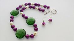 Purple And Green Beaded Necklace And Earrings. Large Green Crystals. Purple And Off White Seed Beads. 925 Sterling Silver Rope Clasp.