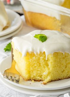 Super Easy Lemonade Cake Recipe is bursting with that sweet and tart lemonade flavor with a lemonade frosting in a slice-able cake!