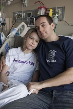 Katy Starck Monte, left, and  her husband FDNY probationary firefighter Joseph at New York-Presbyterian Hospital . She is receiving round the clock care while she waits for a double lung transplant. Her friends have started the #oomphforkaty campaign to show support for her and promote awareness of organ donation.