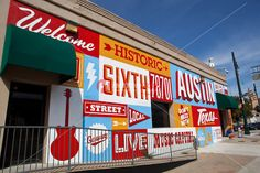 A Hand painted mural, Welcome to Historic Sixth Street, welcomes visitors to the historic 6th street entertainment district in Austin, Texas...