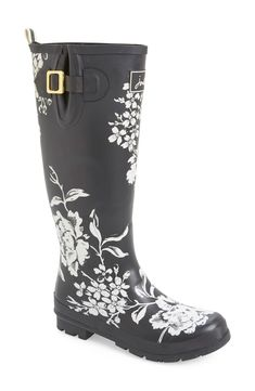 A playful floral print and gold hardware perfects these puddle-proof rain boots.