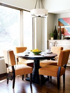 Orange and brown together creates a small, enjoyable earthy dining room. Super Floor Center.