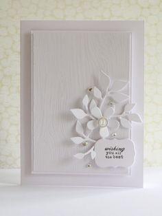 Stamps - PTI tag its 2, Hero Arts designer woodgrain  Ink - Versafine smoky gray, Versamark  Dies - PTI beautiful blooms, jar label  Clear embossing powder  Button  Adhesive stones
