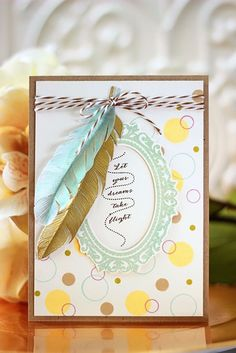 Tutorial on how to make those pretty vellum feathers.  A Cherry On Top http://www.acherryontop.com/articles/Card-Tutorial---Let-Your-Dreams-Take-Flight-17422