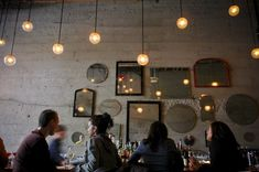 """Stowell serves chic, unadorned Italian food in a narrow modern space whose centerpiece is a huge communal table.""Bon Appétit""Tavolàta is possibly the best thing to happen to Seattle at night ever. Restaurant Lighting, Cafe Restaurant, Bar Lighting, Cafe Shop, Cafe Bar, Seattle Restaurants, Mirror With Lights, Wedding Night, Cottage"