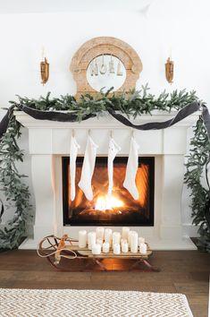 Limestone-look fireplace mantel with stockings and garland Bohemian Christmas, Beautiful Christmas, Simple Christmas, Christmas Home, Christmas Things, Modern Christmas, Christmas Carol, White Christmas, Xmas
