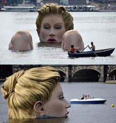 "For ten days, a giant woman sculpture called ""Die Badende"" (""The Bather"") will grace the lake – making Inner Alster essentially the world's biggest bathtub. She rises 13 feet out of the water and appears in a comfortable state of repose, with her knees up, proving quite an obstacle for boaters in the Inner Alster"