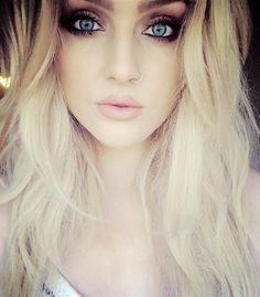 Love that lip color and those big fluffy lips. a girl would KILL for those lips. Not to mention, her pretty blonde hair mixed with the perfect amount of brown/roots, and although her eye makeup is a little much for me, she has BEAUTIFUL blue eyes.